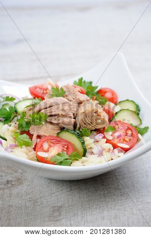 Salad from canned tuna with tomatoes cucumber and orzo