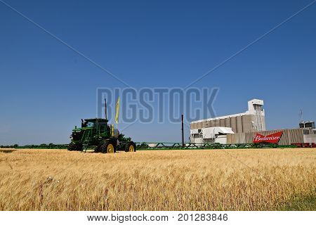 MOORHEAD, MINNESOTA July 22, 2017: Anheuser-Busch sponsored Grower Days honoring farming who grow barley for the malting process which included displaying A John Deere spaying outfit in the adjacent barley field.