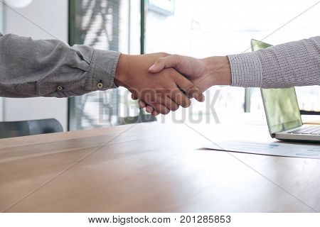 Meeting and greeting concept Two confident Business handshake and business people after discussing good deal of Trading contract and new projects for both companies success partnership co worker.