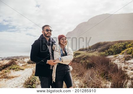 Romantic Couple Admiring A View At The Beach