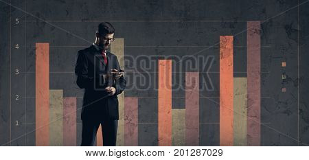 Businessman with smartphone standing over column diagram background. Business, office, career, job concept.