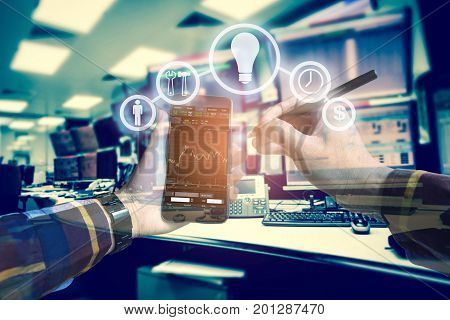 Double exposure photo hand touching mobile phone for using business tool iconsInvestment manager with computer monitor background for stock trading concept.