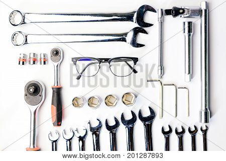 Top view of Working construction and mechanic safty glasses drilltape square on white background. flat lay.