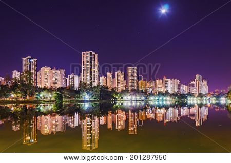 Beautiful City Lights Reflected On The Water Of The Lake At Night