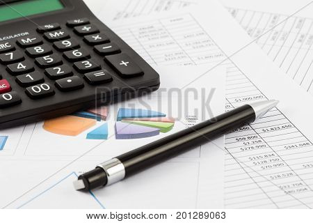 A Monthly budget spreadsheet pen and calculator