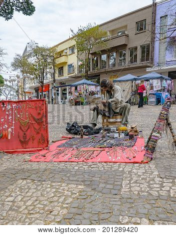 Hippie Selling His Art On Londrina Downtown