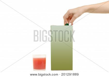 Female hands multi-layered juice in a cardboard box and in a glass on a white background isolation