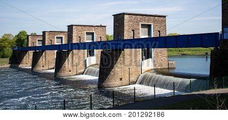 an image of a historic bridge built of stone crosses a river