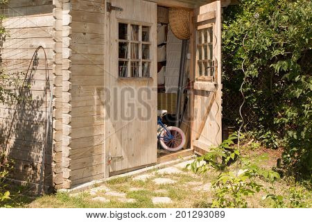 Garden With Gardening Tools And Wooden Shed Garden-house