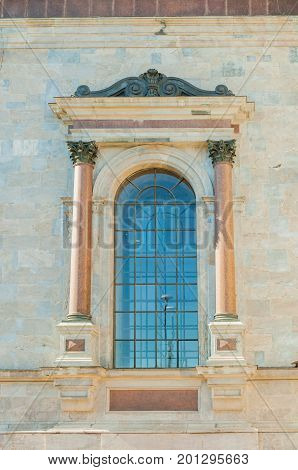 St Petersburg Russia - window of St Isaacs Cathedral with sculpture details. Architecture closeup view of St Petersburg Russia landmark