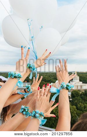 Girls Show Hands Whis Decorating Boutonniere Of Flowers And Ribbons. Buttonhole. Party Style Boho. M