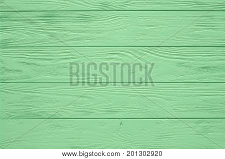 Green mint painted wood board texture and background. Green mint natural wooden background. Aged wood planks pattern. Wooden surface. Horizontal timber texture. Green mint wood barn. Green mint color wood barn. Wood board background. Green mint wooden bar