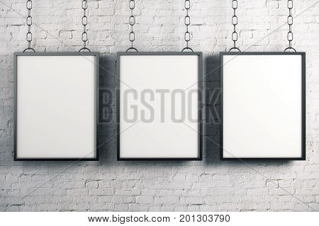 Empty rectangular banners hanging on white brick wall background. Gallery advertising exhibition concept. Mock up 3D Rendering
