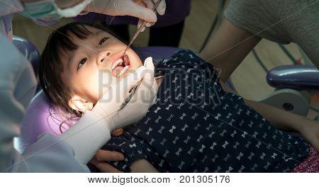 Teeth Checkup At Dentist's Office. Dentist Examining Asian Girls Teeth
