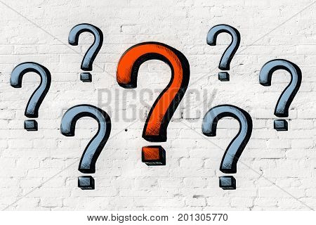 Drawn question marks on brick wall background. Enquiry concept