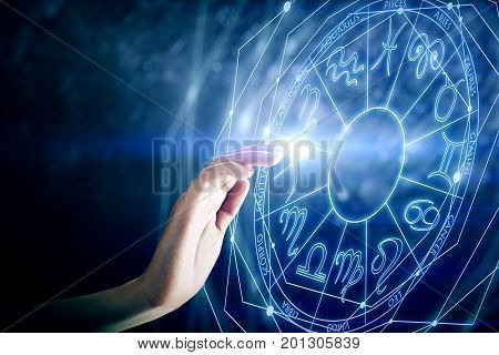 Hand with zodiac sign horoscope circle. Future and aries concept