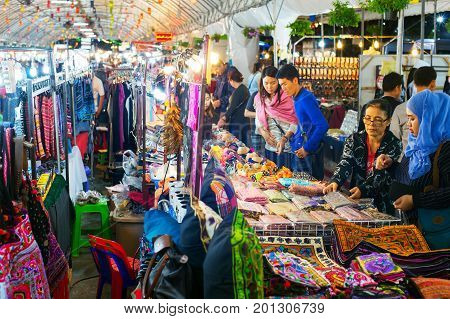 People At A Night Market. Thailand