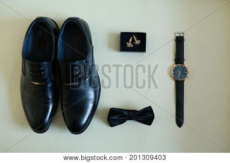 beautiful and stylish accessories of the groom for a wedding in the form of shoes, butterflies, watches and cuff links