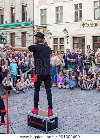 WROCLAW POLAND - AUGUST 14 2017: Street Performer With Audience At Rynek Market Square In Wroclaw
