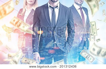 Close up of three members of a business team wearing suits and standing in a city under a dollar rain. Toned image double exposure