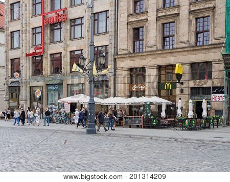 WROCLAW POLAND - AUGUST 16 2017: Tourists In Front of McDonald's Restaurant At Rynek Market Square In Wroclaw