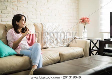 Hispanic Woman Watching Movies By Herself