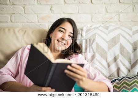 Woman Relaxing With Her Favorite Book