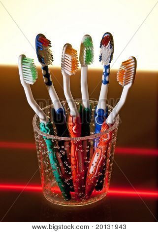 toothbrushes in cup, studio shoot
