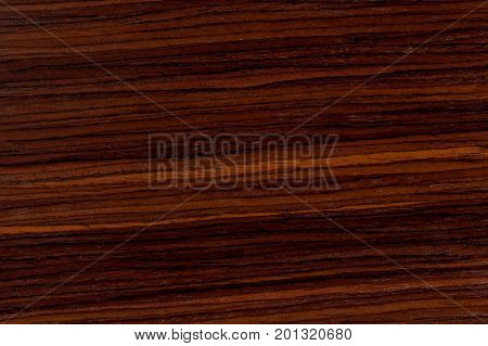 Dark rosewood background, natural wooden texture with patterns. Extremely high resolution photo.