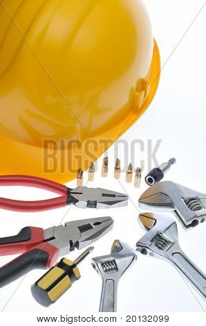 a mix of construction tools over a white background