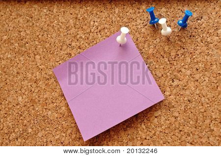 Single blank note paper attached to a wooden wall