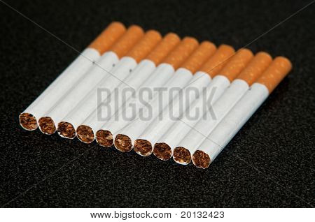 Couple cigarettes close up photo in studio