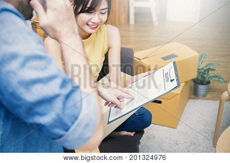 Start up small business entrepreneur SME or freelance woman and man working with box at home concept Young Asian small business owner at home office online marketing packaging box and delivery