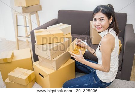 Start up small business entrepreneur SME or freelance woman working with box at home concept Young Asian small business owner at home office online marketing packaging box and delivery