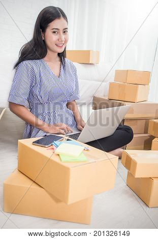 Start up small business entrepreneur SME or freelance woman working at home concept Young Asian small business owner at home office on line marketing packaging and delivery SME concept