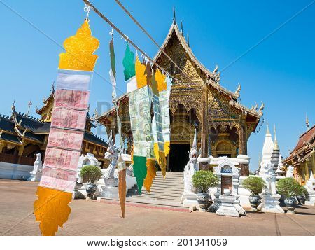 Beautiful temple with money from donation hanging in Thailand. Public place for worship in Buddhism