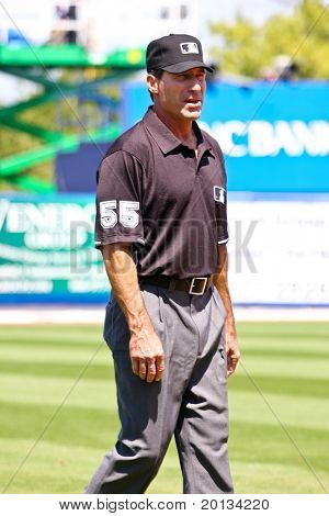 PORT ST. LUCIE, FLORIDA - MARCH 23: Baseball umpire Angel Hernandez walks along third base during a game between the New York Mets and Atlanta Braves on March 23, 2010 in Port St. Lucie, Florida.