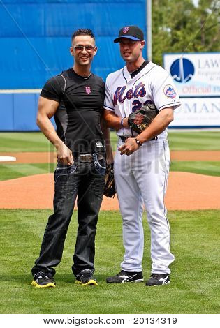"""PORT ST. LUCIE, FLORIDA - MARCH 24: MTV reality star Mike Sorrentino, aka """"The Situation"""",(left) and Mets outfielder Chris Carter (right) at spring training on March 24, 2010 in Port St. Lucie, Fla."""