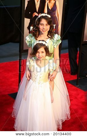 """NEW YORK - APRIL 6: Actress Emily Evan Rae (rear) and Savannah Paige Rae (front) arrive on the red carpet for the premiere of """"Date Night"""" on April 6, 2010 in New York City."""
