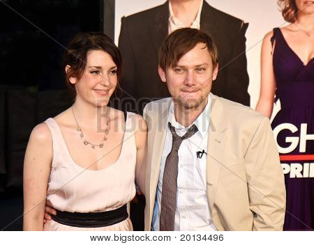 "Actress Melanie Lynskey and her husband, Jimmi Simpson attend the movie premiere of ""Date Night"" at the Ziegfeld Theatre on April 6, 2010 in New York City."