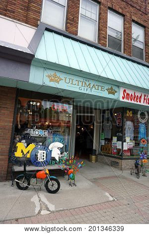 CADILLAC, MICHIGAN / UNITED STATES - MAY 31, 2017:  The Ultimate Gift Shop offers smoked fish, pies, t-shirts, and miscellaneous merchandise, on Mitchell Street in Downtown Cadillac.