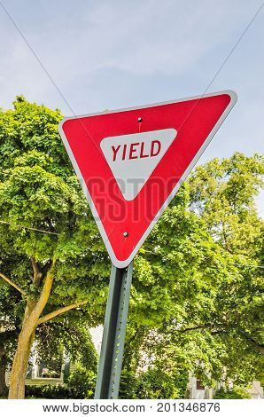 Red and white triangular sign letting motorists know they have to yield the right of way
