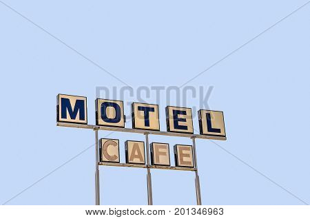 Old sign for a motel and cafe on Route 66