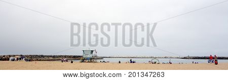 VENTURA CA USA - JULY 4 2013: Beachgoers enjoying holiday at Ventura city beach near Harbor Village Southern California