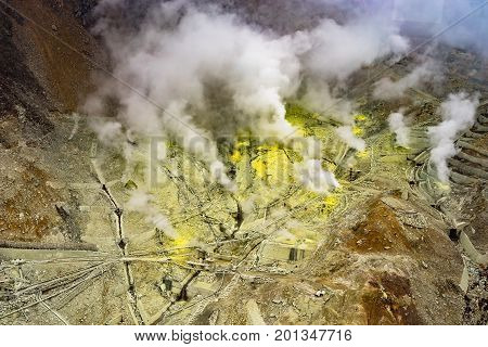 Sulphur gas protruding from ground of active mountain named Owakudani located in Hakone Japan. This area also can view Fuji mountain on bright day. Photo taken from Hakone ropeway.