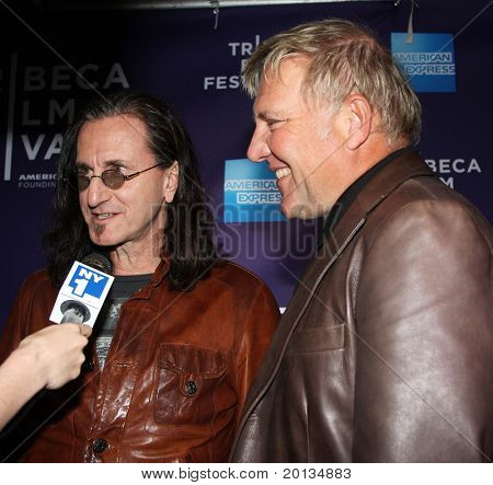 "NEW YORK - APRIL 24: Alex Lifeson and Geddy Lee attend the ""RUSH: Beyond the Lighted Stage"" premiere during the 2010 TriBeCa Film Festival at the School of Visual Arts Theater on April 24, 2010 in New York City."