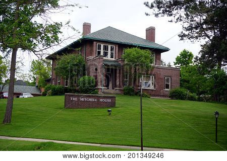 CADILLAC, MICHIGAN / UNITED STATES - MAY 31, 2017:  The historic Charles T. Mitchell House is a brick home that is listed on the National Register of Historic Places.