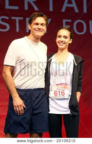 NEW YORK - MAY 1: Dr. Mehmet Oz and Jessica Alba attend the 13th Annual Entertainment Industry Foundation Revlon Run/Walk for Women in Times Square on May 1, 2010 in New York City.