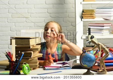 Kid Near Pile Of Textbooks And School Supplies