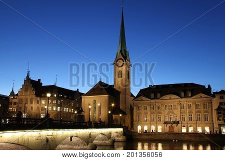 Zurich Fraumunster Church with Bridge and river at blue hour